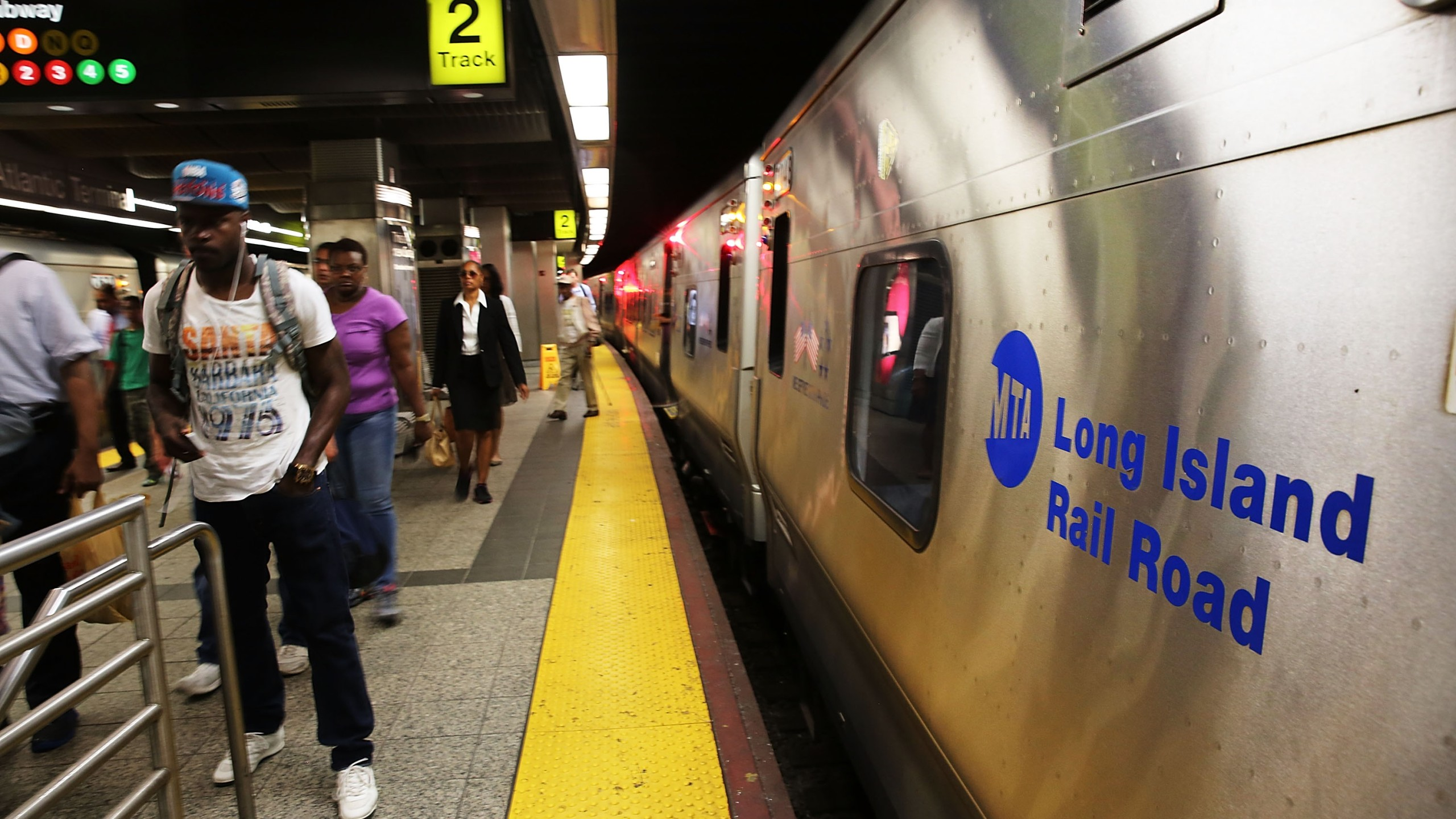 NEW YORK, NY - JULY 15:  A Long Island Rail Road (LIRR) train sits at the platform on July 15, 2014 in the Brooklyn borough of New York City. Currently there are no new negotiations scheduled between the Metropolitan Transportation Authority (MTA) and unions representing Long Island Rail Road workers after talks broke off abruptly on July 14. Around 300,000 riders, commuters and tourists, rely on the railroad every day which travels between Long Island and New York City. With Long Island Rail Road union leaders threatening to strike as early as Sunday, July 20, with pay increases and health care contributions are some of the issues being debated.  (Photo by Spencer Platt/Getty Images)