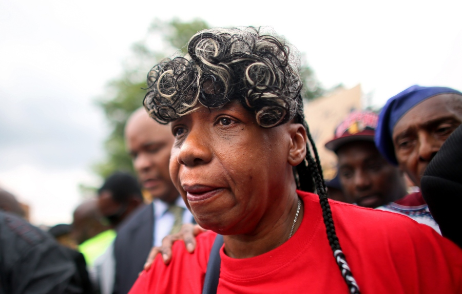 NEW YORK, NY - AUGUST 23: Gwen Carr, mother of police violence victim Eric Garner, marches during a rally against police violence on August 23, 2014 in the Staten Island borough of New York City. Thousands of marchers are expected for today's rally which will be attended by the family of Michael Brown and the Reverend Al Sharpton among others. Eric Garner, 43, died while he was being arrested for allegedly selling loose cigarettes in front of a bodega and was put into a chokehold during a confrontation with police. An investigation is pending and the police officer who allegedly used the illegal chokehold has been placed on modified duty. (Photo by Yana Paskova/Getty Images)