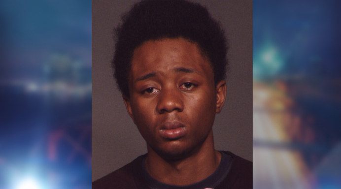 Police say Alonzo Brown kicked the woman and baby to the ground before stealing the victim's cellphone.