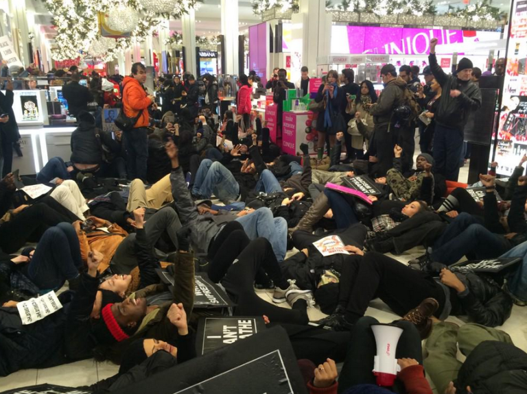 Protesters staged a die-in in Macy's in Herald Square. (Photo: Charles Wade/@akacharleswade)