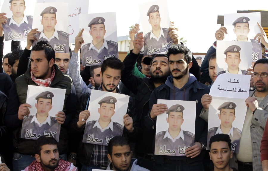 Activists carry posters with a portrait of the Jordanian pilot Maaz al-Kassasbeh, who was captured by Islamic State (IS) group militants on December 24 after his F-16 jet crashed while on a mission against the jihadists over northern Syria, during a rally calling for the release of Al-Kassasbeh in the Jordanian capital Amman on February 3, 2015. Jordan vowed to do all it could to save the pilot held by IS after the jihadists killed a Japanese journalist they had been holding. IS has been demanding the release of an Iraqi jihadist on death row in Jordan in exchange for Kassasbeh's life, and Amman said it would hand her over if given proof that he is still alive. (KHALIL MAZRAAWI/AFP/Getty Images)