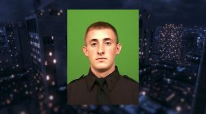 NYPD officer Brian Moore, 25, was shoot in the cheek after a man open fired on him and his partner in Queens Saturday night. (Photo: NYPD)