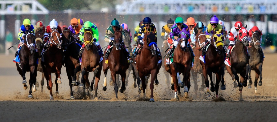 Jockey Victor Espinoza rode California Chrome into the finish line to win the 2014 Kentucky Derby on May 3. Espinoza will be riding favorite American Pharoah in this year's derby. (Photo: Getty Images)