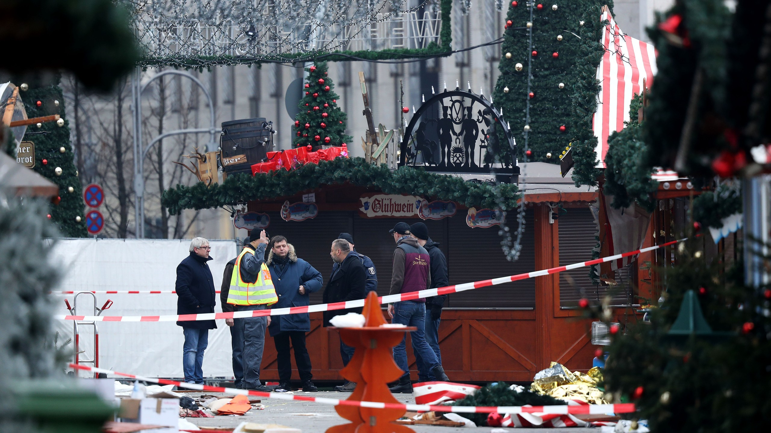 Workers are seen at a Berlin Christmas market on Dec. 20, 2016, a day after a truck plowed through a crowd, killing at least 12. (Sean Gallup/Getty Images)