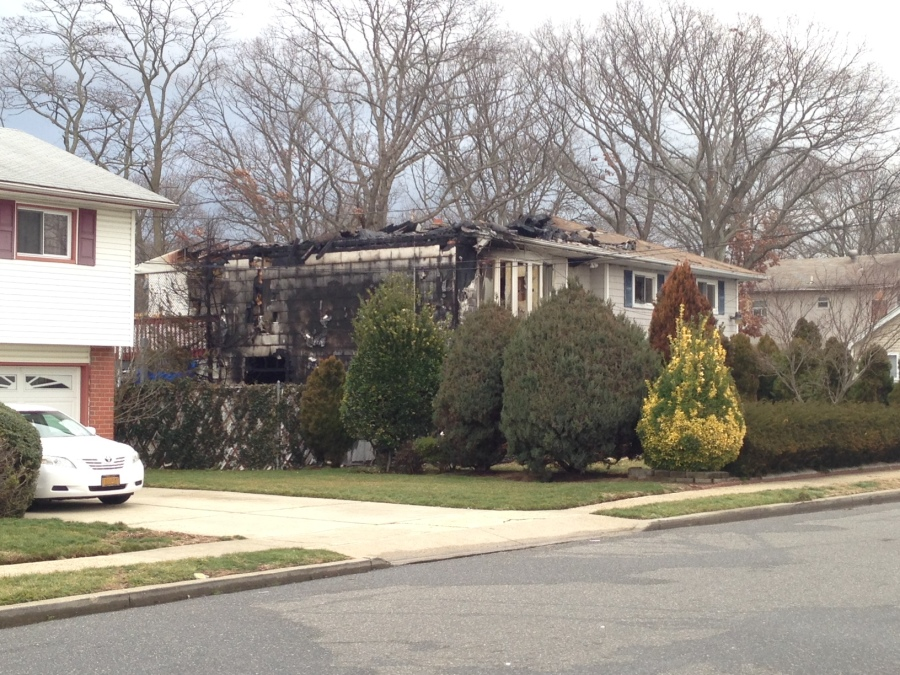 One person died after a fire broke out in a home in Amityville. (Keith Lopez/PIX11 News)