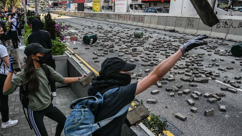 Man set on fire in Hong Kong hours after protester shot by police