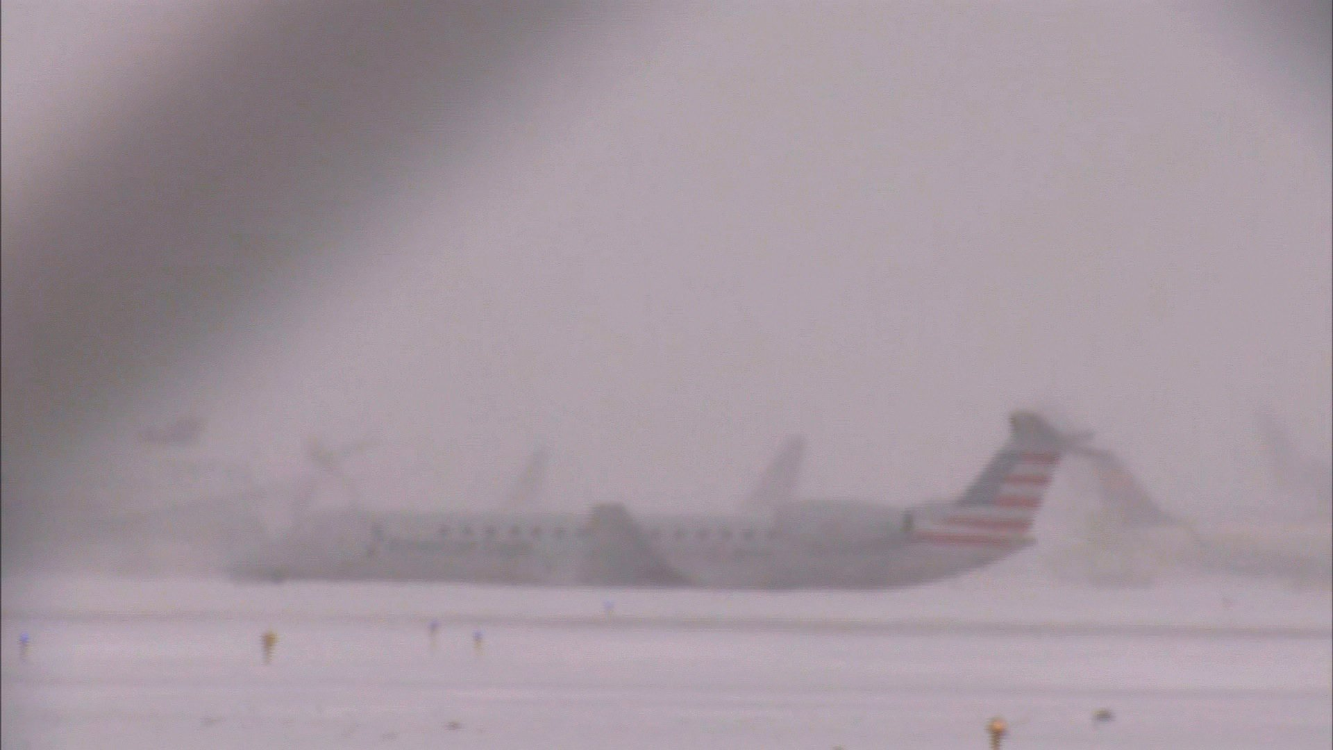 Plane slides off snowy runway at Chicago's O'Hare International Airport