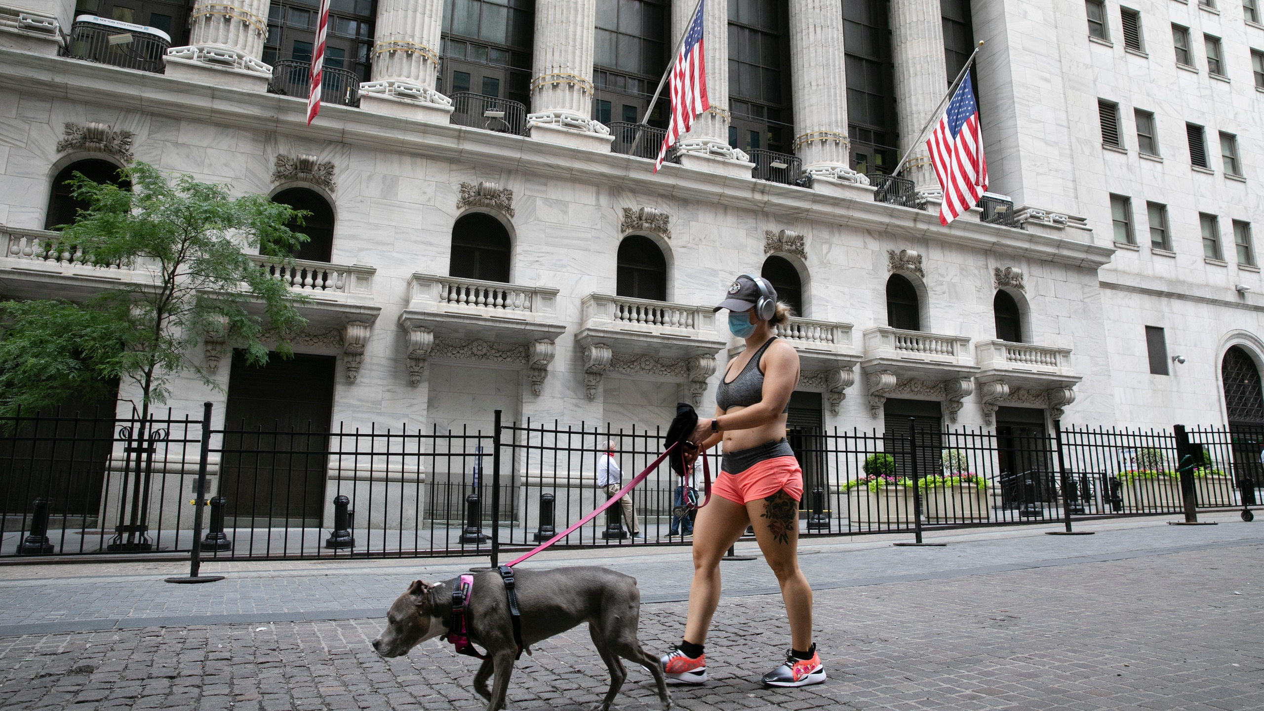 Woman in mask walks dog in NY