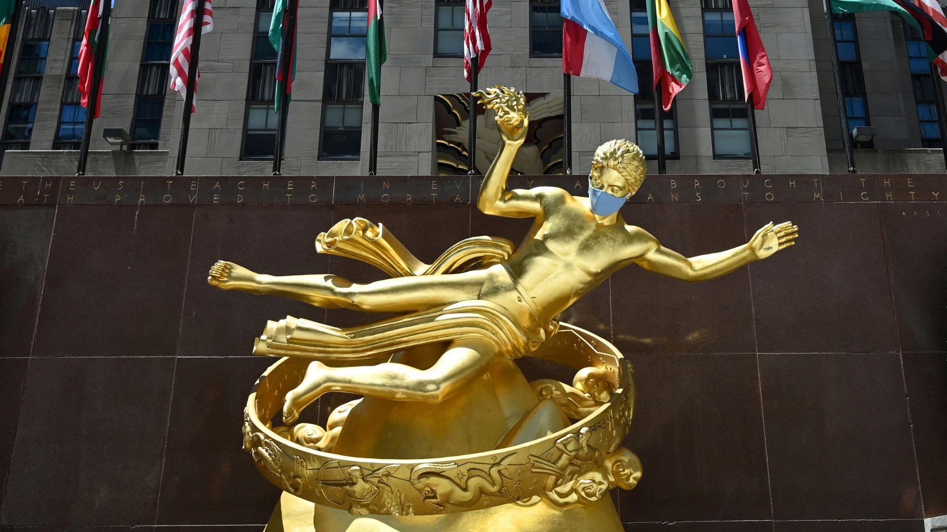 New York City reopening Phase 2 Rockefeller Center statues in masks