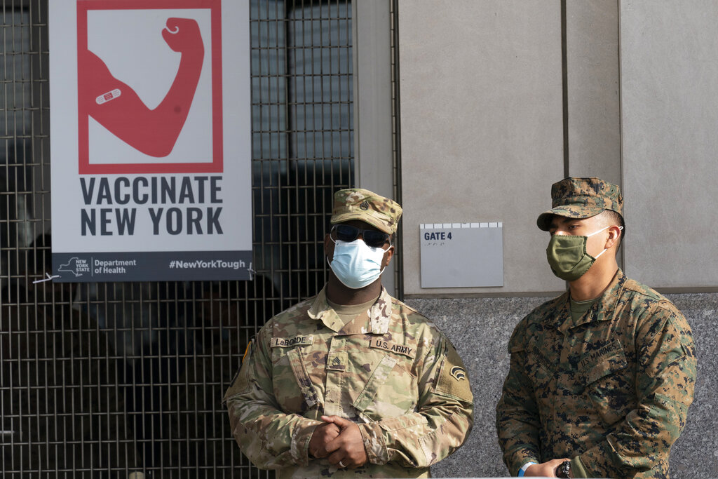 National Guardsmen stand outside a COVID-19 vaccination site at Yankee Stadium
