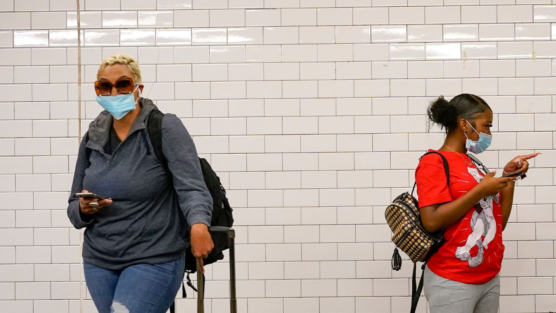 women-wear-masks-subway-station-nyc.jpg