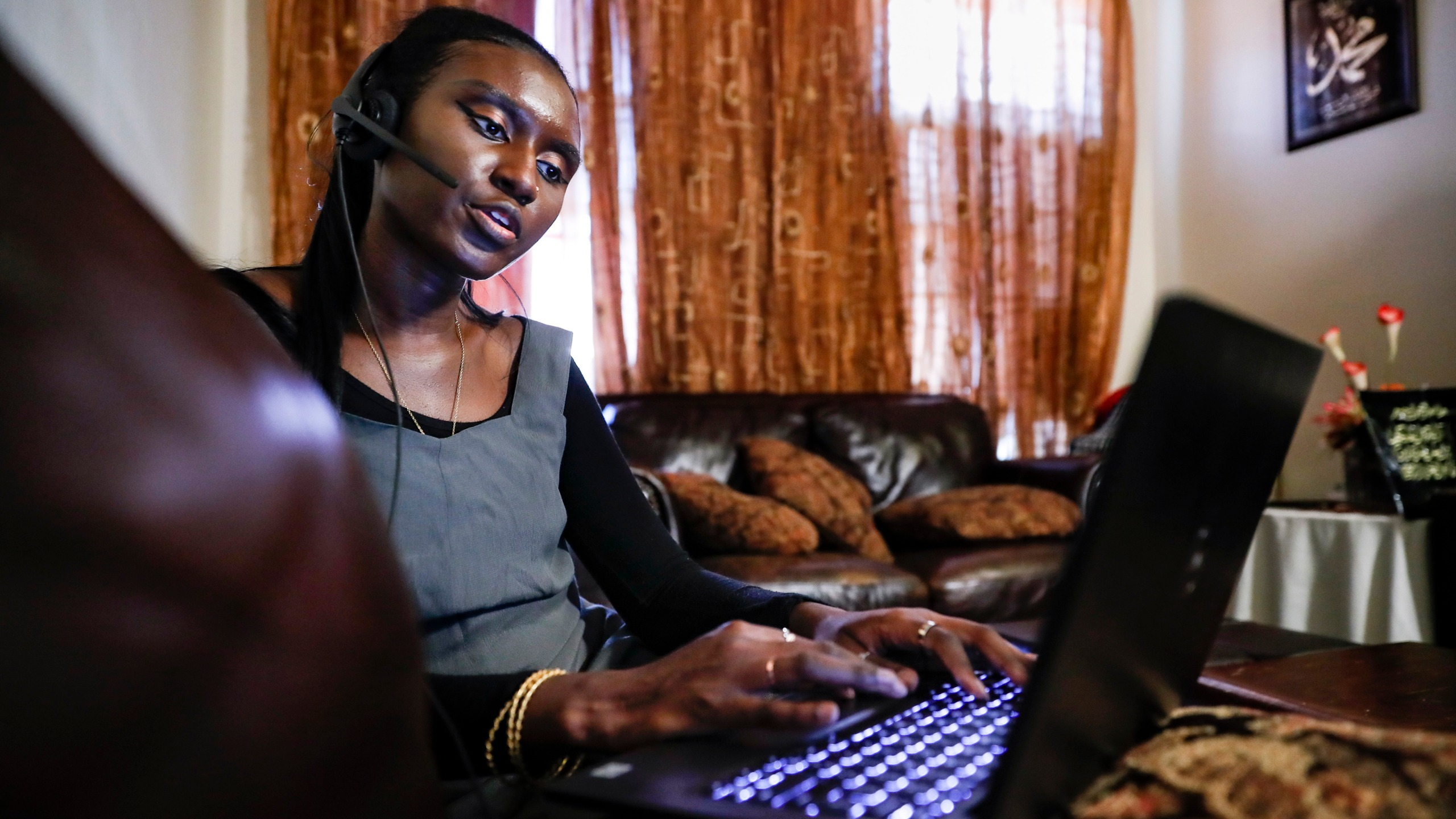 Maryama Diaw, a contact tracer with New York City's Health + Hospitals battling the coronavirus pandemic, sets up her remote calling system at her home before reaching out to potential patients, in New York.