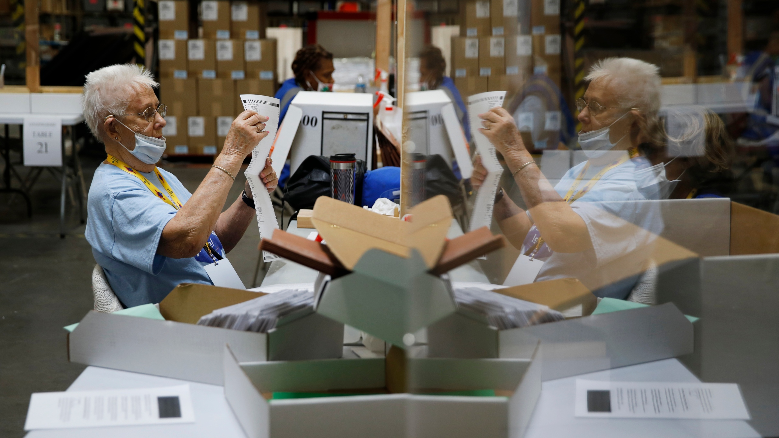 Election workers process ballots