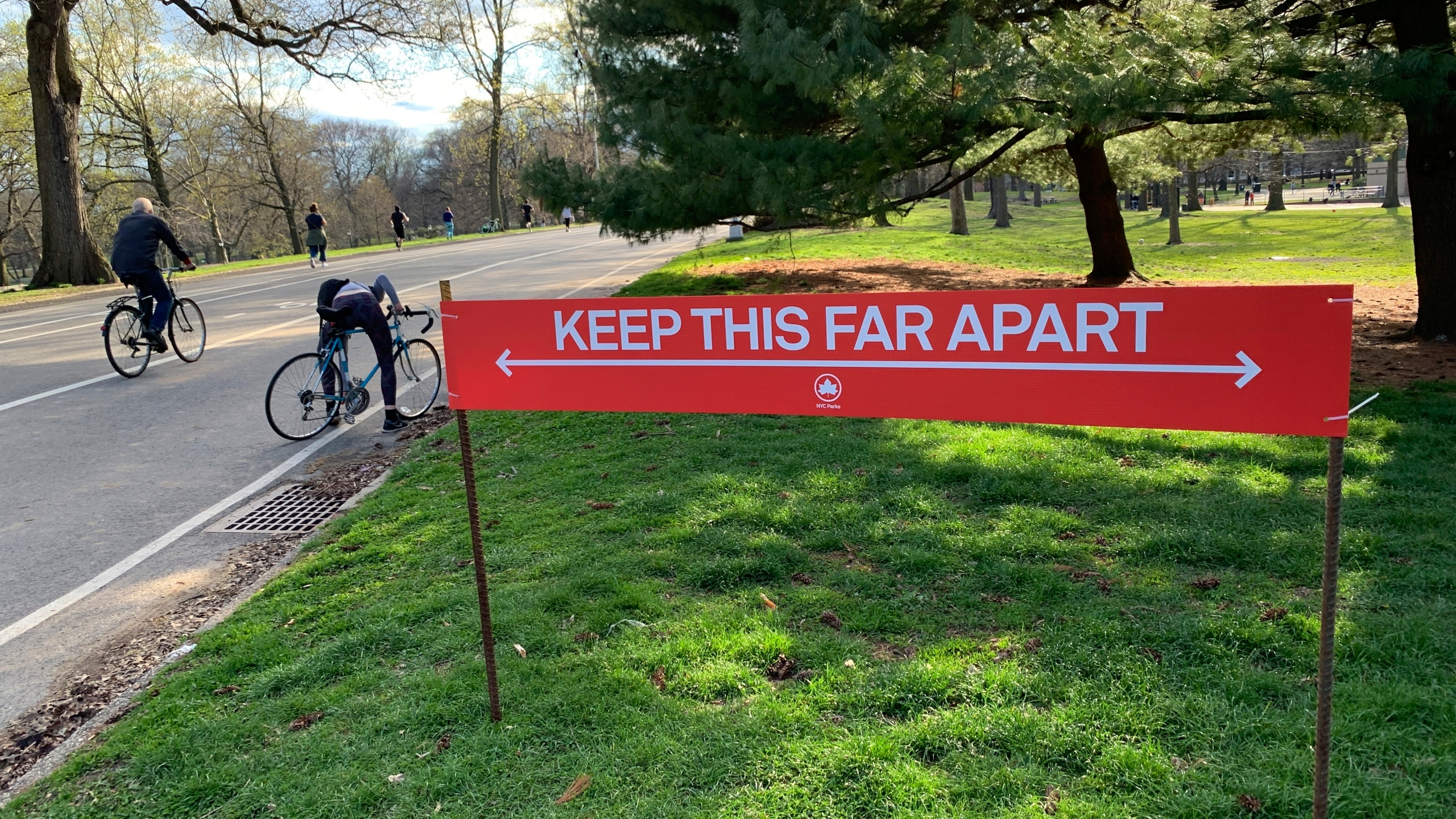 Signage urging social distancing is seen in Prospect Park in the Brooklyn borough of New York, Wednesday, April 8, 2020.