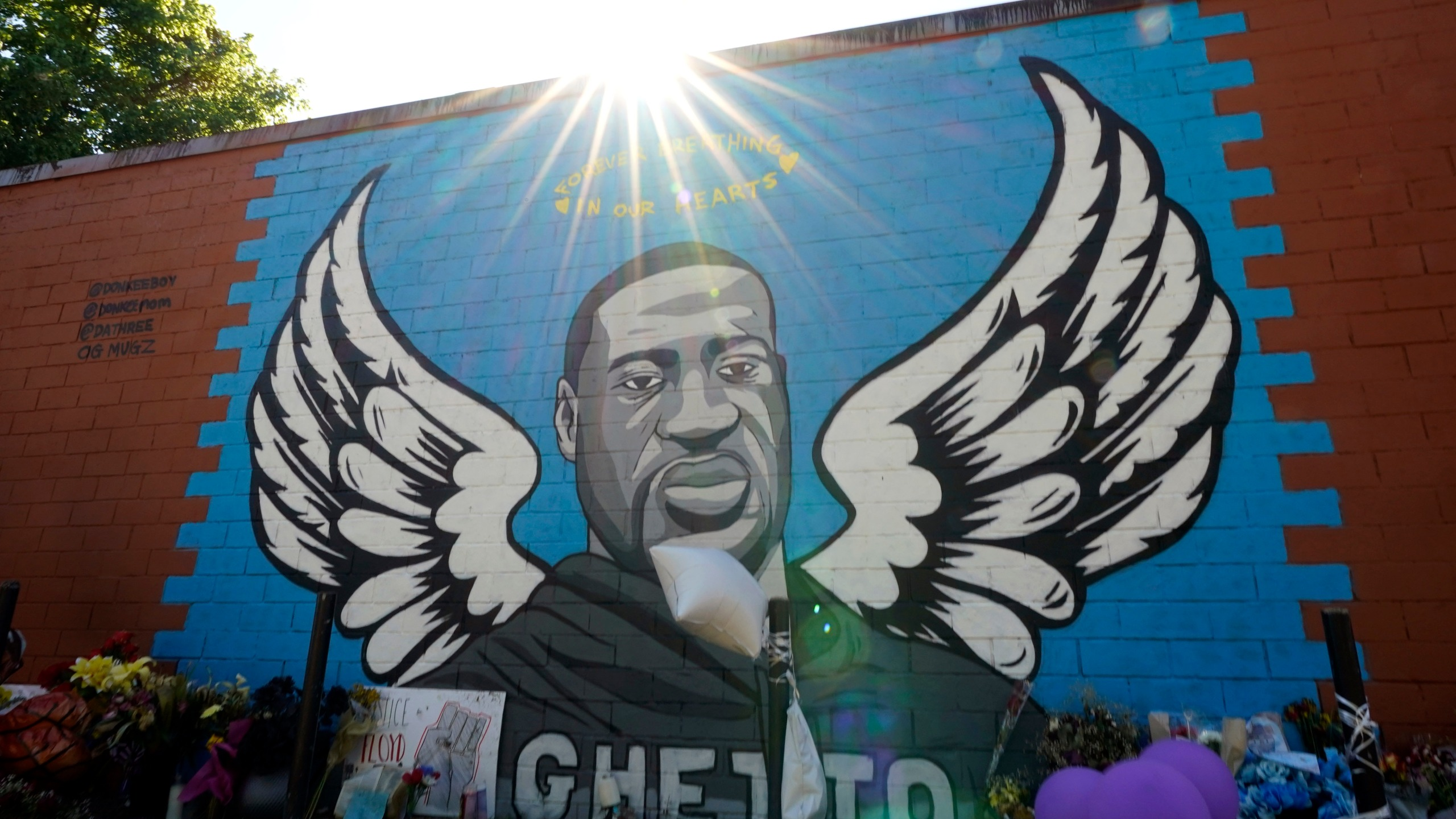 A mural of George Floyd is shown