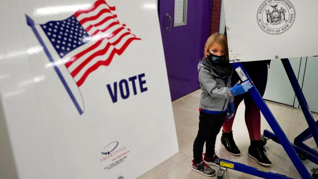 woman votes on election day on upper west side