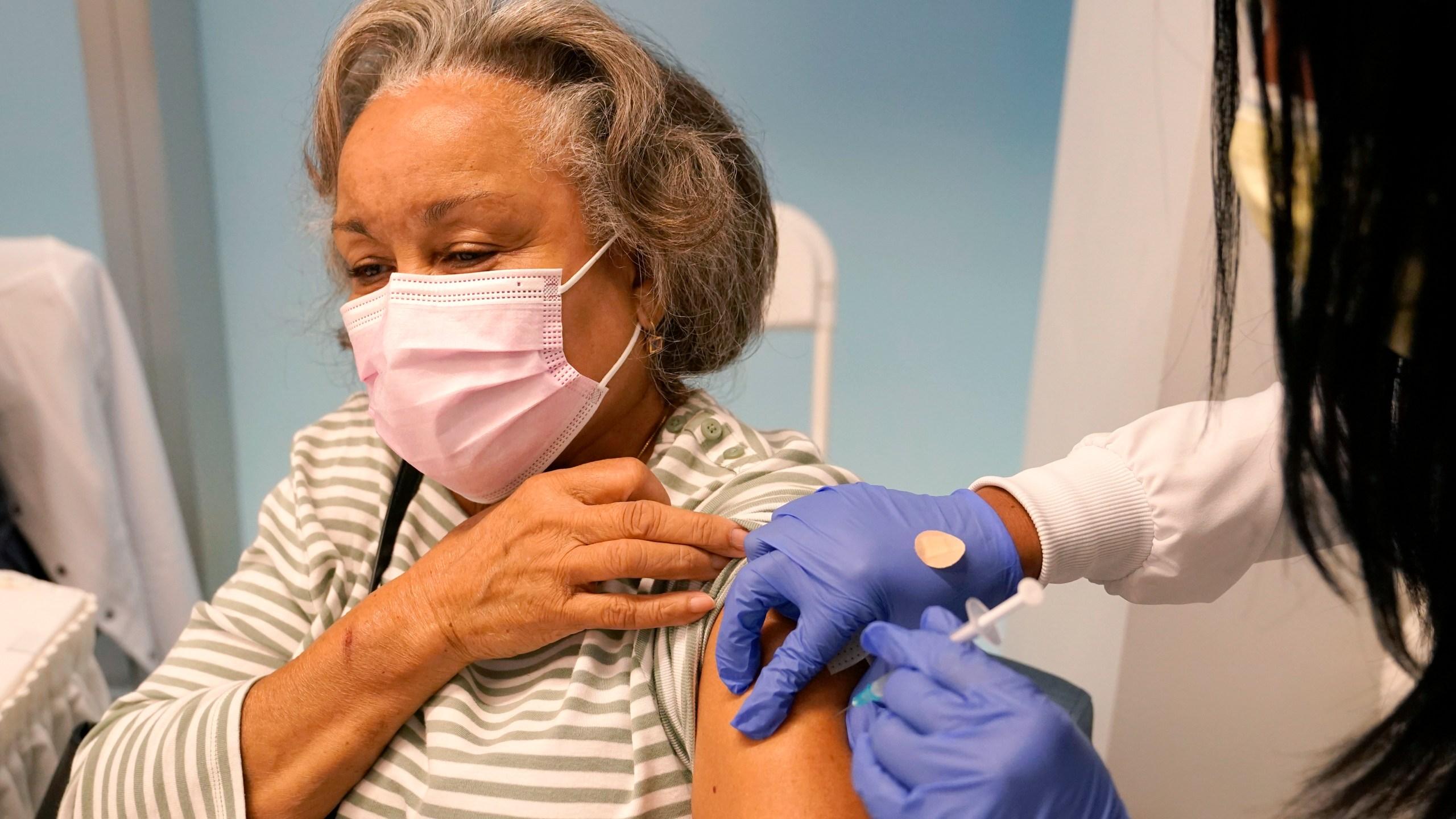 Woman getting COVID vaccine shot