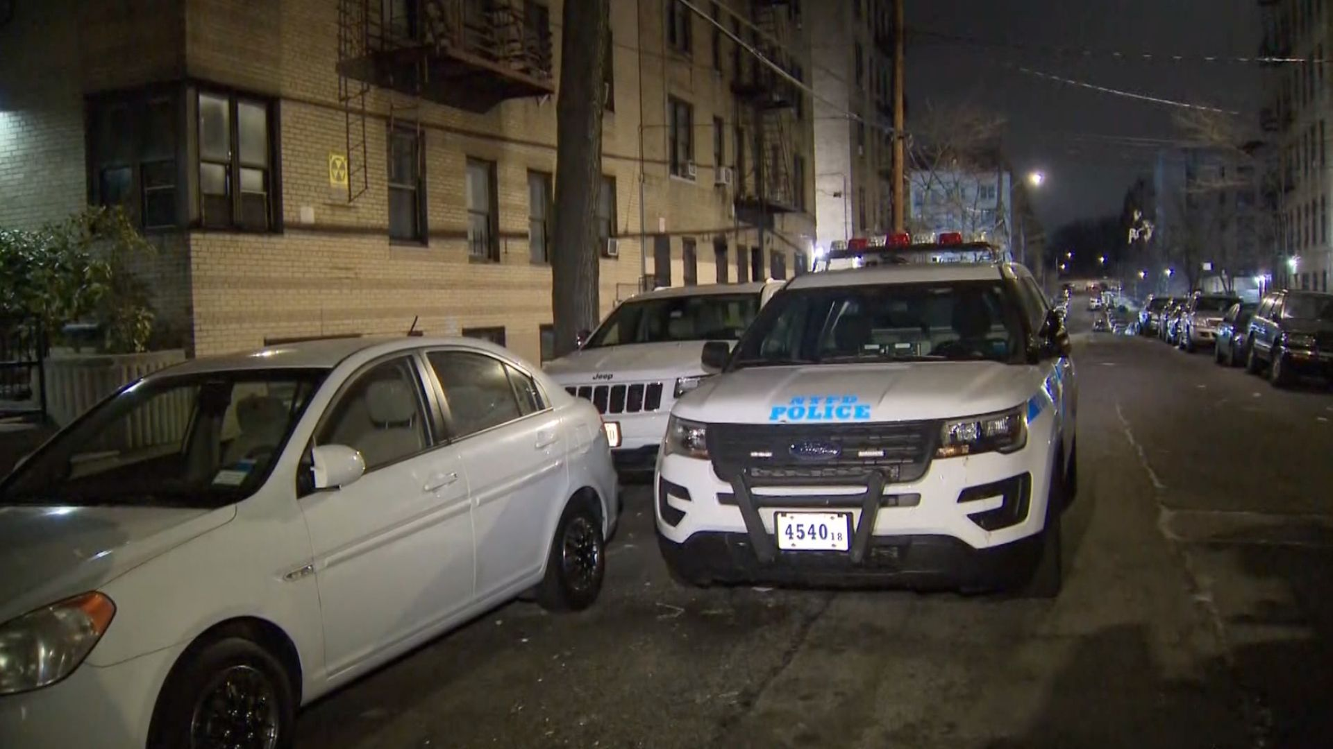 Police outside a Bronx building after a 20-year-old woman was fatally shot in the head inside a Norwood apartment on March 17, 2021, according to the NYPD said. (PIX11 News)