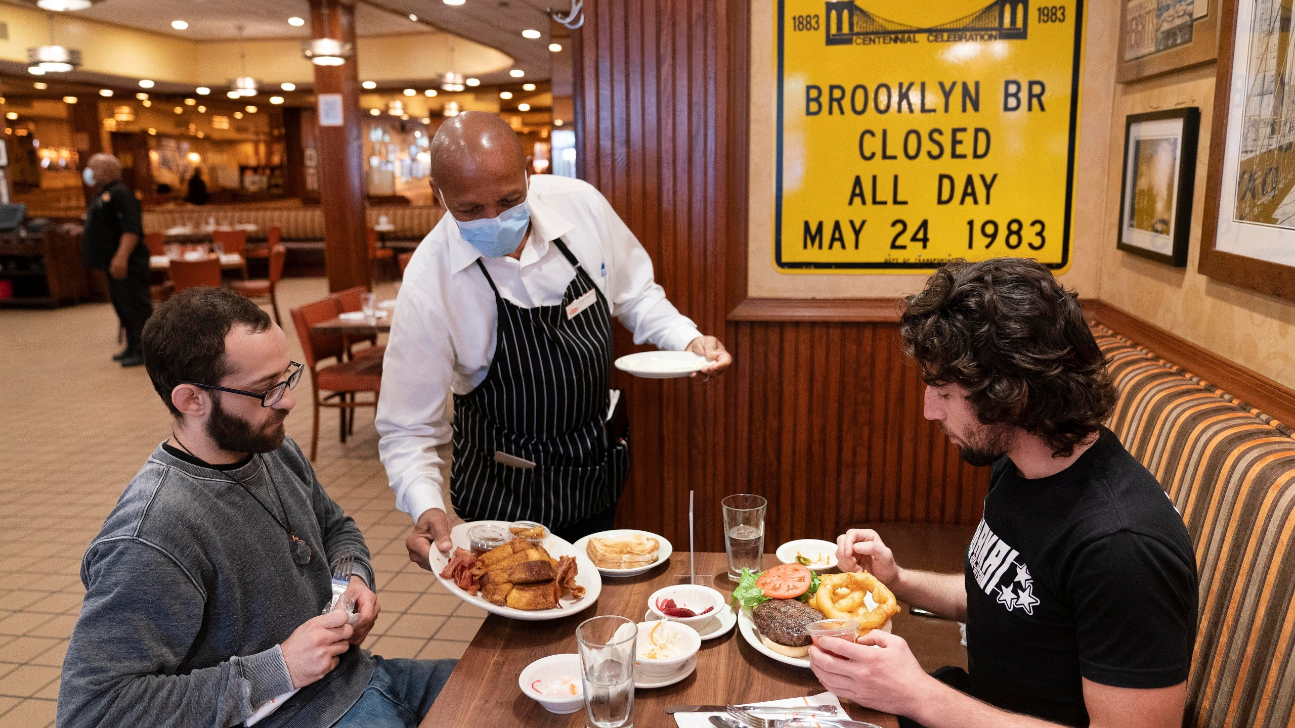 Customers get meal in NY restaurant