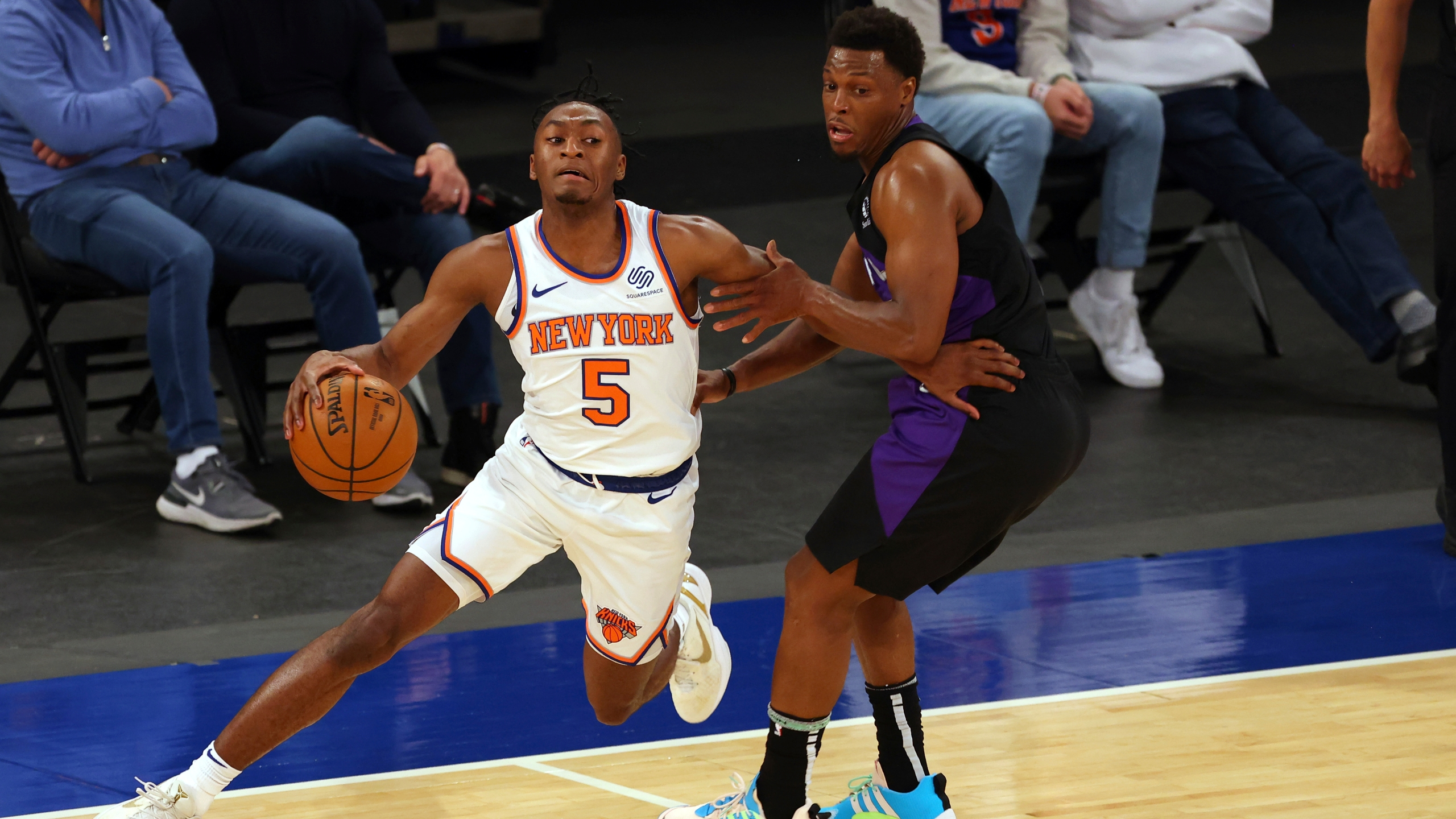 New York Knicks' Immanuel Quickley (5) attempts to get past Toronto Raptors' Kyle Lowry, right, who defends during an NBA basketball game at Madison Square Garden, Sunday, April 11, 2021, in New York. (Rich Schultz/Pool Photo via AP)