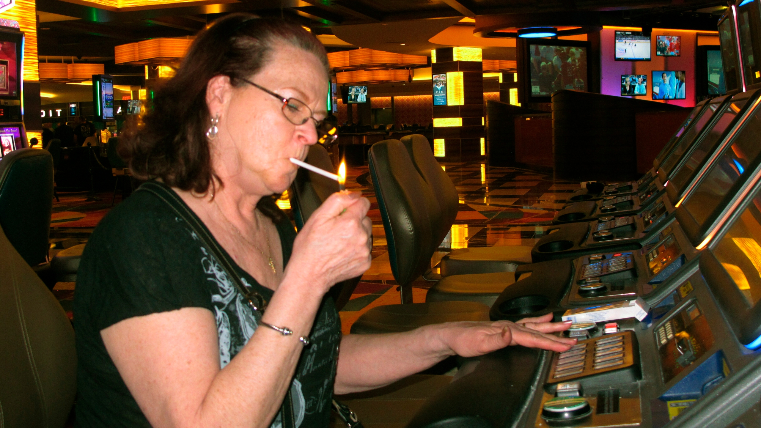 NJ casino patron lights cigarette