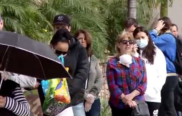 people wearing face masks to protect against covid