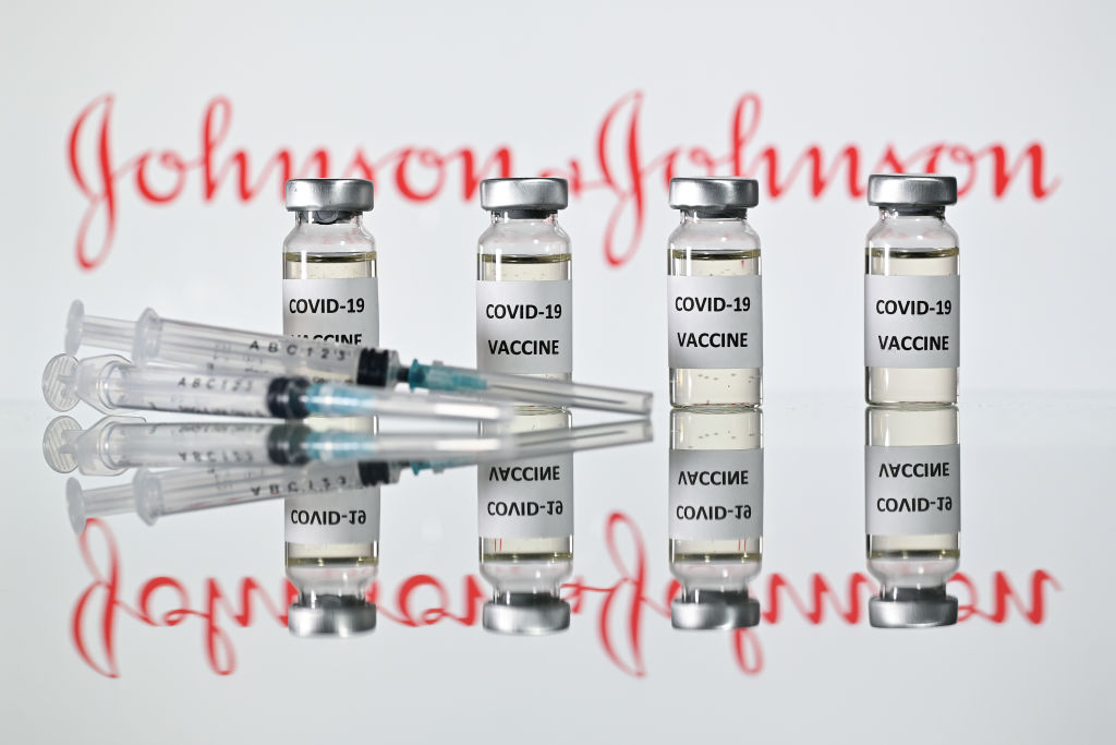 COVID-19 vaccine vials and the Johnson & Johnson logo