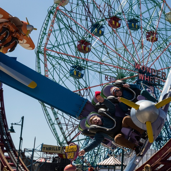 File photo: People ride amusement park rides at Coney Island on March 29, 2015 in Brooklyn. (Andrew Burton/Getty Images)