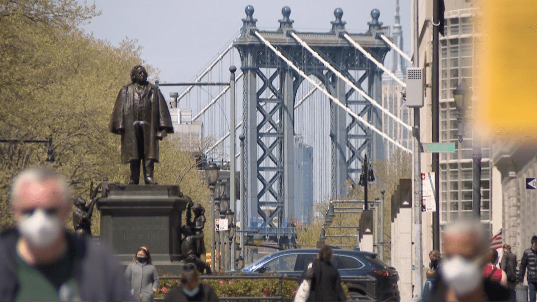 New York City residents wearing masks enjoy spring weather
