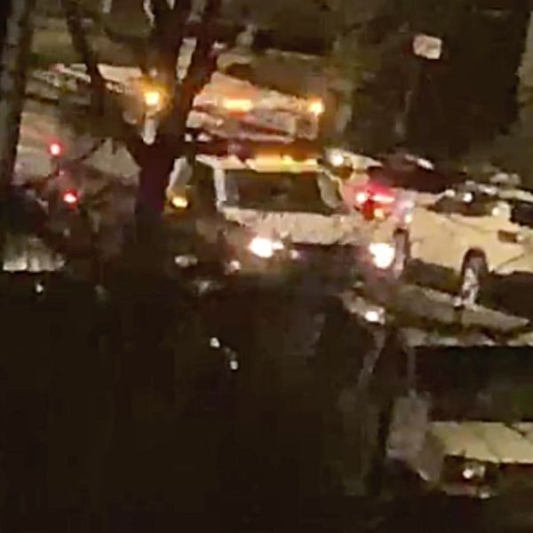 An ambulance leaves the scene after a man, 24, was shot four times after an argument on a Bronx street in the Williamsbridge section late Thursday night, April 8, 2021, according to police. (NYPD)