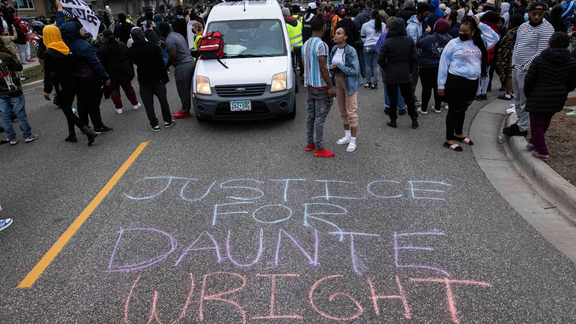Protesters clash with police after a man, Daunte Wright, was shot and killed by local law enforcement on Sunday April 11, 2021, in Brooklyn Center, Minn. (AP Photo/Christian Monterrosa)