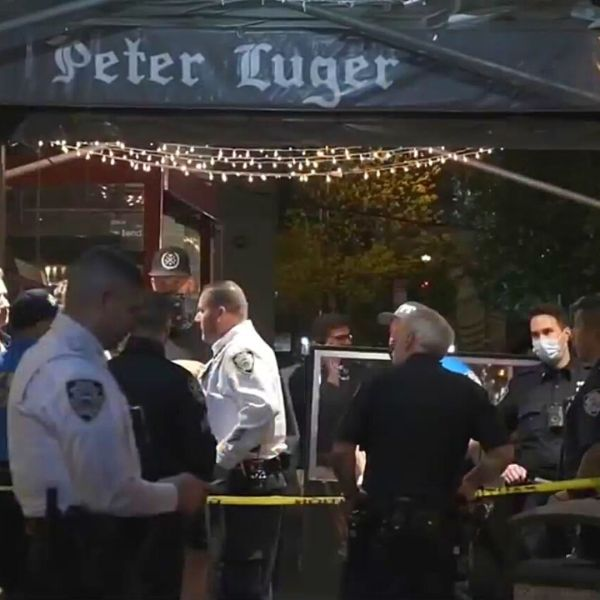 Police on the scene after a shooting at Peter Luger Steak House on Thursday night