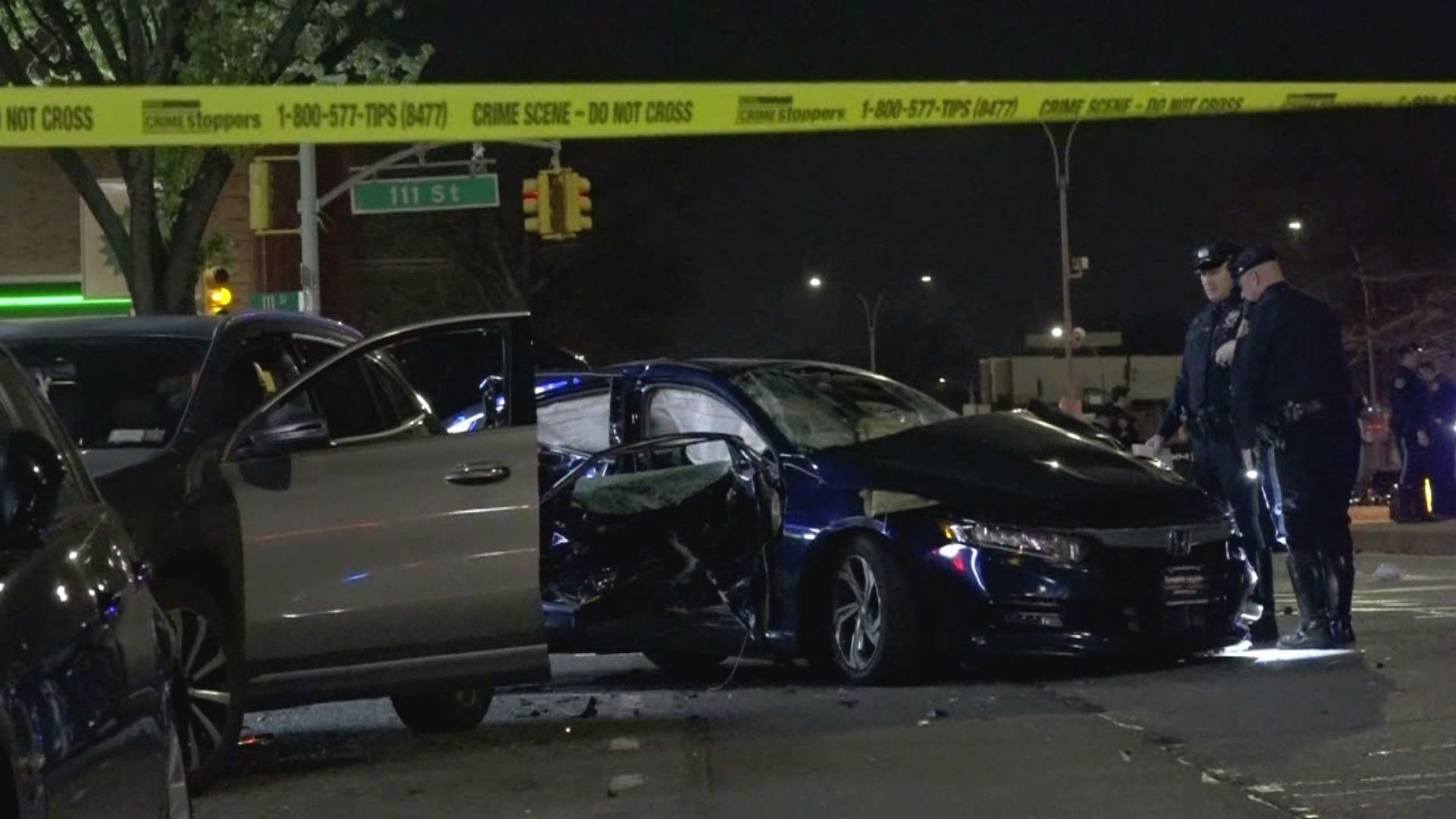 Scene of a deadly multiple-vehicle crash at the intersection of 111th Street and Atlantic Avenue in the Richmond Hill area of Queens on April 21, 2021.