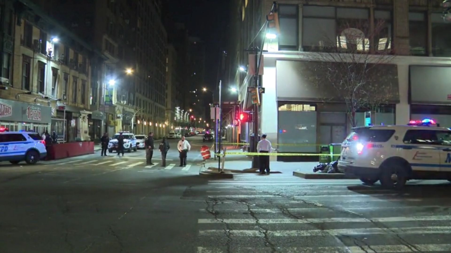Police on the scene at West 38th Street and Eighth Avenue after a tourist was struck by a stray bullet near Times Square on April 7, 2021, according to the NYPD (PIX11 News)