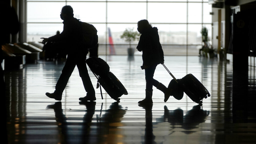 airport travelers walking with suitcases