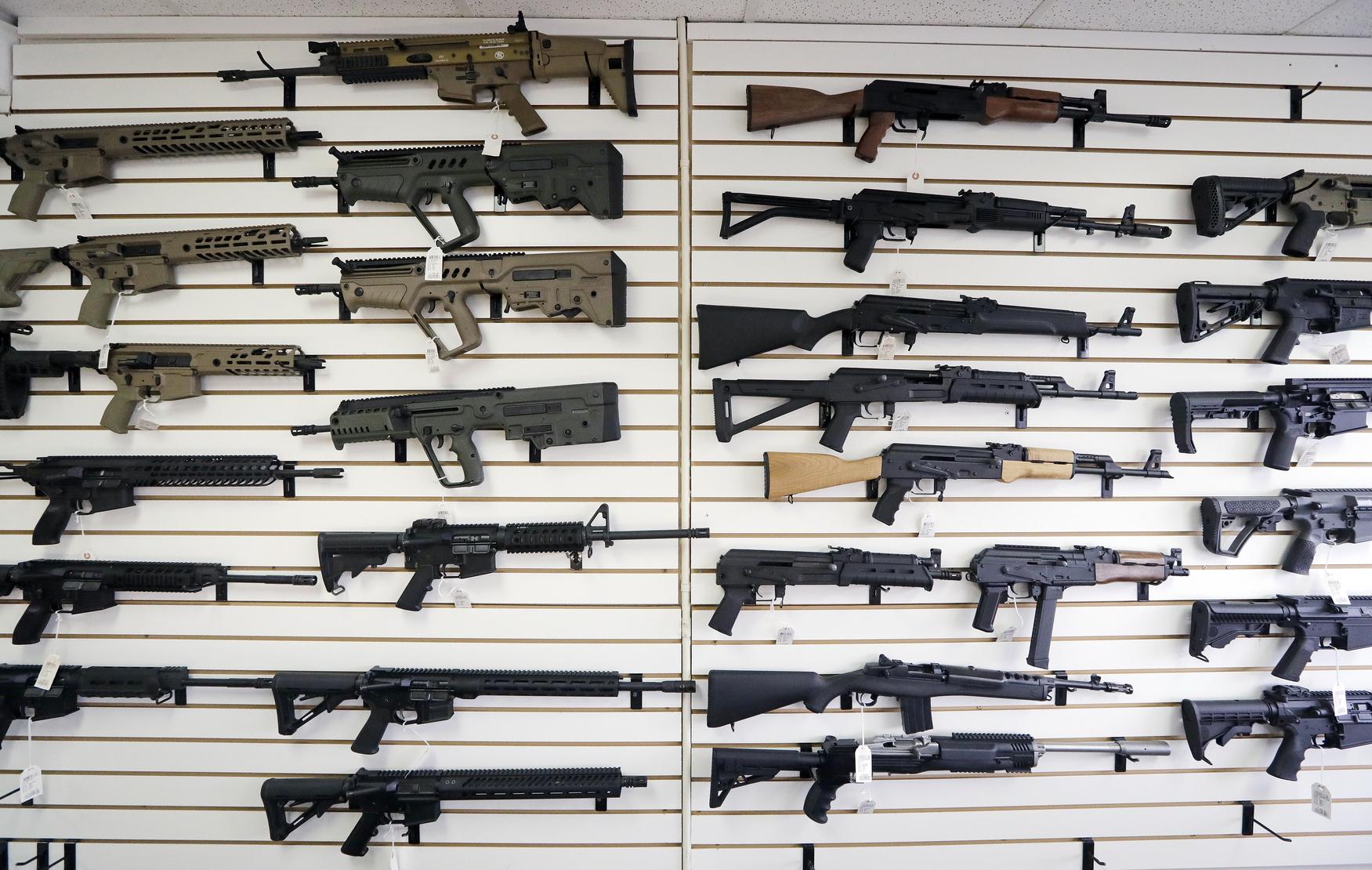 rifles on a wall at a gun shop