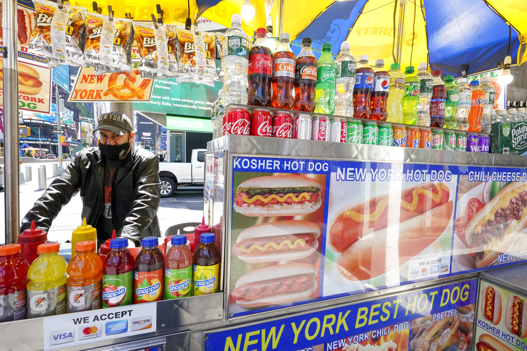 A hot dog cart vendor in Times Square