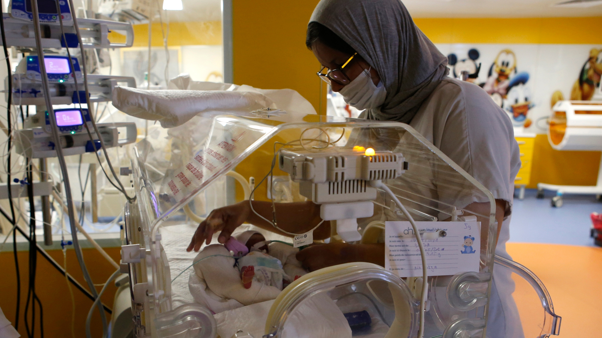 Moroccan nurse takes care of baby