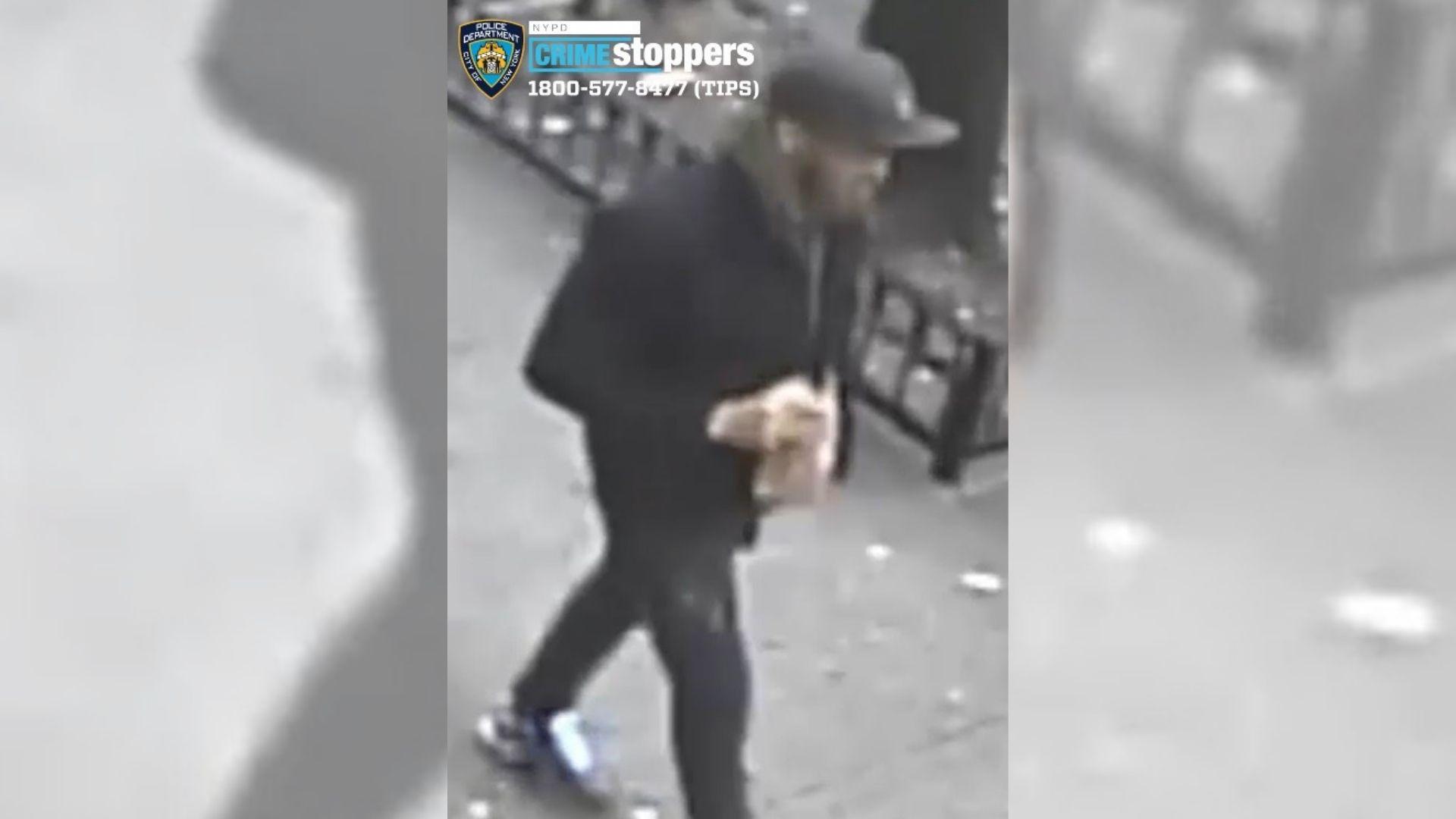 Bronx punch suspect walking down street in Belmont
