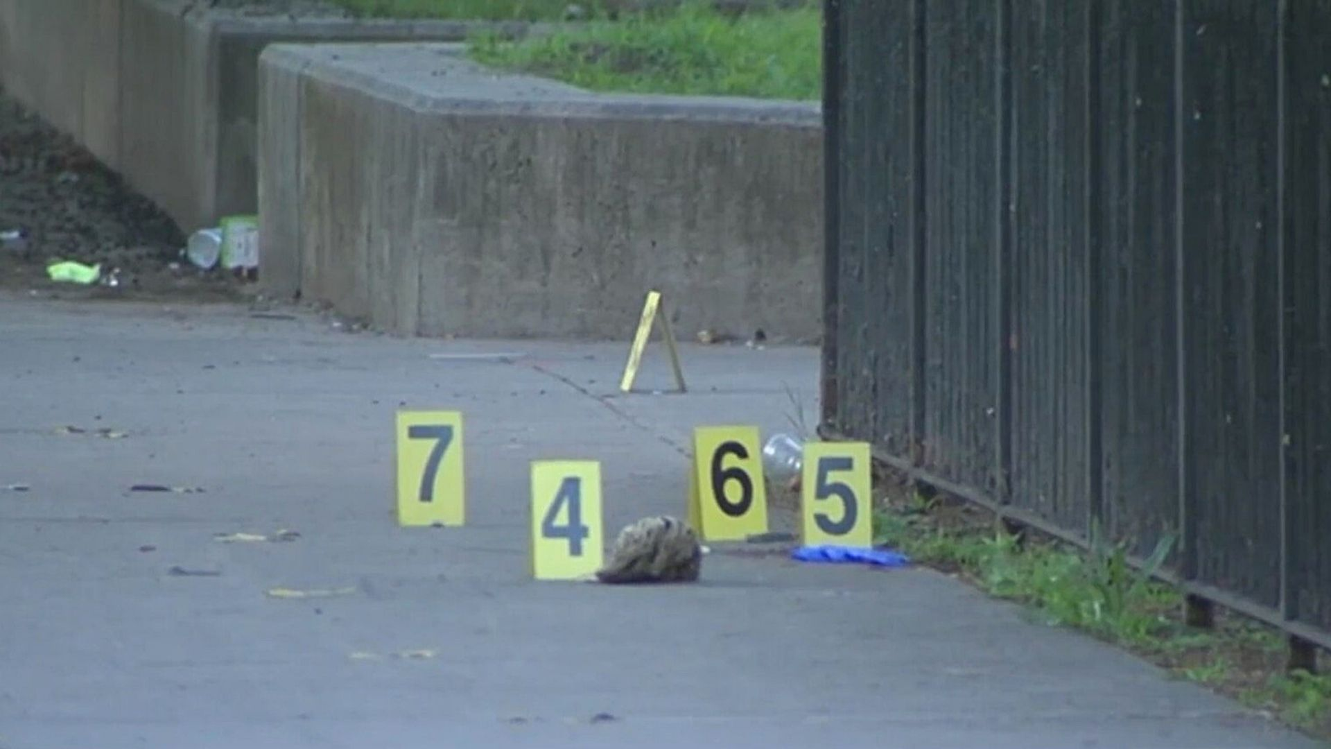 Evidence markers after a shooting in Brooklyn