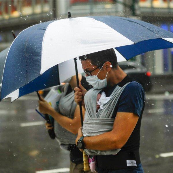 man walks with umbrella during rain in nyc