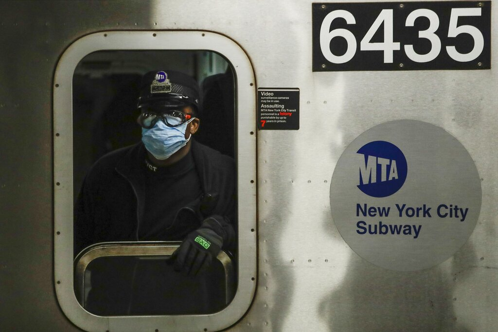 MTA worker wears face mask on subway