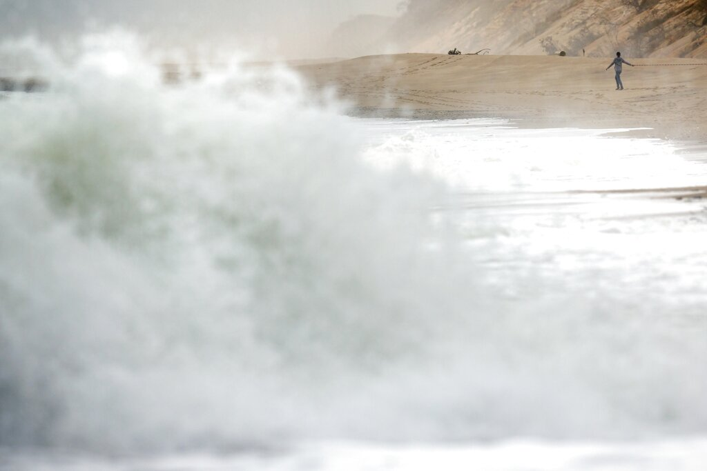 wave crashes on beach