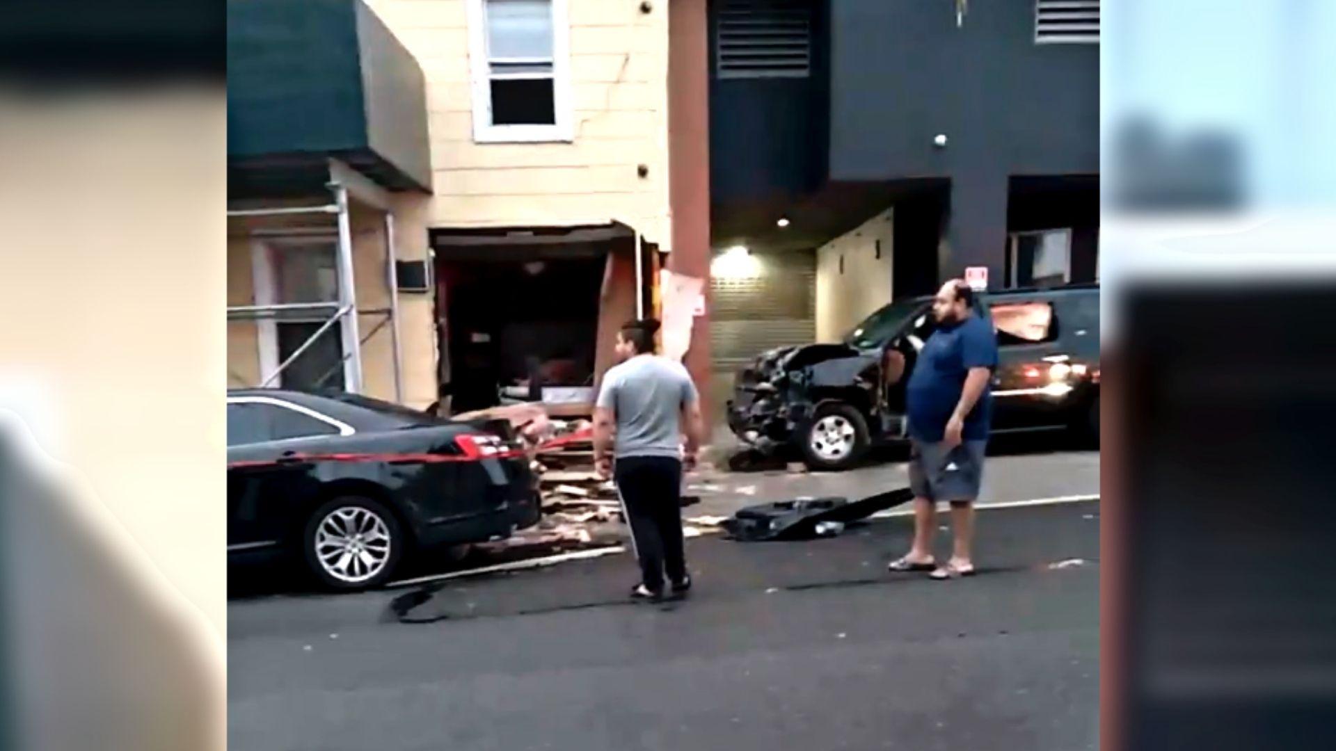 SUV crashes into Queens apartment building